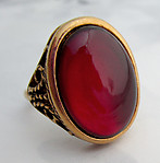 adjustable gold tone filigree ring w red cabochon - j6554