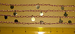 5 feet copper coated figaro chain w brass charms - f1491