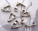 18 pcs. silver tone fold over clasps 10x3mm - f2839