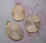 9 pcs. gold tone starburst stamping charms 19x14mm - f4566