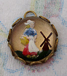 reverse painted intaglio dutch girl in raw brass lace setting charm pendant 13mm - f4443