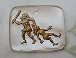glass reverse painted intaglio caveman dragging cavewoman by the hair 26x22mm - d252