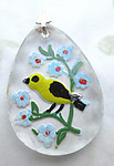 glass reverse painted intaglio bird and flowers scalloped edge pendant 31x22mm - d421