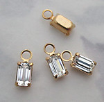 12 pcs. baguette rhinestones in gold tone plated pronged settings 5x3mm - f3743