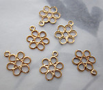 18 pcs. gold tone plated flower charms 9mm - f3769