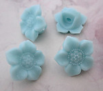 4 pcs. light turquoise blue plastic shank buttons 17mm - f5329