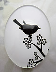 Glass flat back black and white cabochon w bird 40x30mm - f6946