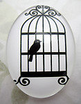 Glass flat back black and white cabochon w bird 40x30mm - f6952