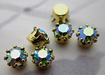 18 pcs. Swarovski MCC machine cut crystal chrysolite AB rhinestones in raw brass settings ss19 - s357