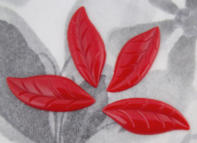 12 pcs. red leaf plastic flat back cabochons 25x10mm - f2779