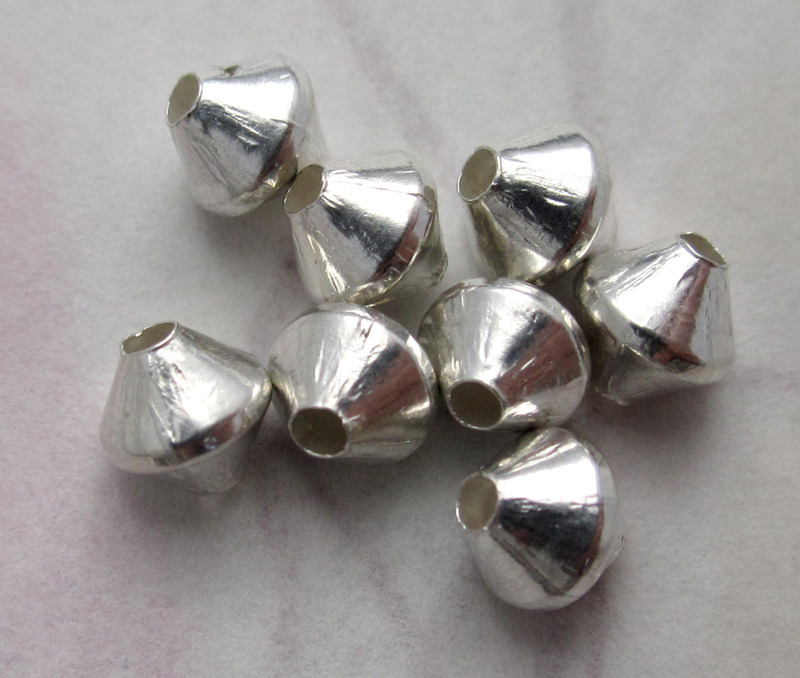 24 pcs. silver tone plated brass bicone beads 5mm - f4539