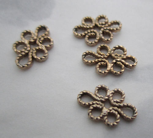 12 pcs. raw brass flower twisty charm connectors 11x8mm - f3671