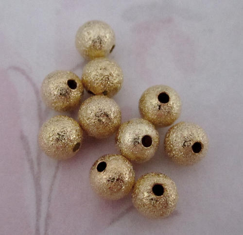 10 pcs. gold tone textured metal beads 6mm - f4598