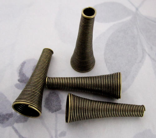 4 pcs. antiqued brass cone shaped spring coil beads 31x12mm - f4702
