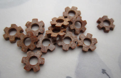 12 pcs. brown plastic flat flower beads 9mm - f5736