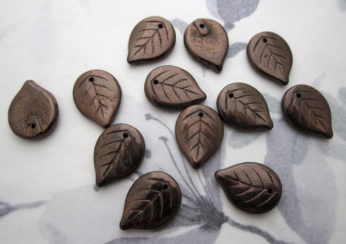 12 pcs. glass bronze coated leaf bead drop charms 18x13x3mm - f5836