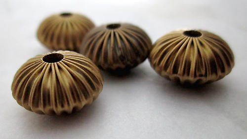 12 pcs. raw brass corrugated flying saucer beads 12x7mm - r436