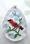 glass reverse painted intaglio bird and flowers scalloped edge pendant 31x22mm - d420