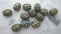 18 pcs. teal green plastic beads w gold embossed intaglio design mid century abstract paisley 15x12mm - s19