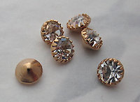 18 pcs. MCC machine cut crystal rhinestones in gold tone prong settings 6mm - s222